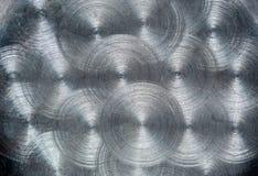 Die Beschaffenheit einer Oberfläche eines Stahlblechs mit einem konzentrischen Muster lizenzfreies stockfoto