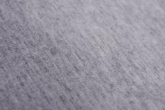 Die Beschaffenheit eines grauen Baumwollstoffes Lizenzfreies Stockbild