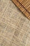 Die Beschaffenheit und das Muster des Segeltuches und des japanischen Mattenhintergrundes Stockbild