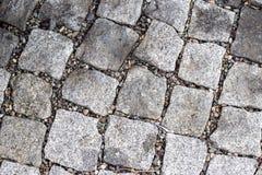 Die Beschaffenheit von Pflastersteinen, Steinstraße lizenzfreies stockbild