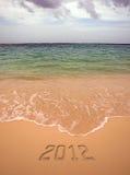 Die Beschreibung auf dem Sand - 2012 Stockbild