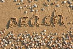Die Beschreibung auf dem Sand Lizenzfreie Stockbilder