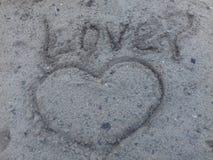Die Beschreibung auf dem Sand Stockfotografie