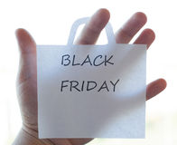 Die Black Friday-Aufschrift auf einem Blatt Papier Stockfotografie
