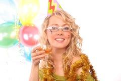 Die Blondine mit dem Glas des Champagners Stockbild