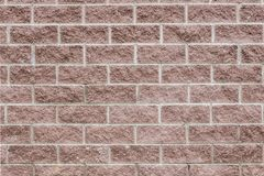 Die braune Blockwand-Hintergrundbeschaffenheit des modernen Builings Lizenzfreie Stockbilder