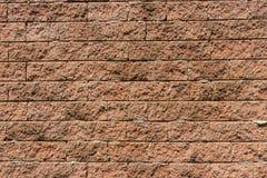 Die braune raue Backsteinmauer Stockfoto
