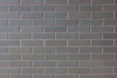 Die braune Ziegelstein- oder Blockwandhintergrundbeschaffenheit Stockbild