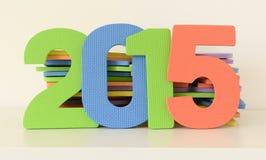 Die bunten 2015 Anzahlen von flachen Schaumspielwaren Stockfotografie