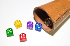 The die is cast. A traditional die is a cube marked on each of its six faces with a different number of circular patches or pits called pips stock photo