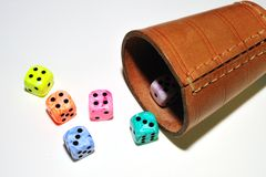 The die is cast. A traditional die is a cube marked on each of its six faces with a different number of circular patches or pits called pips stock photos