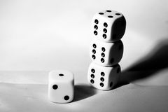 The die is cast. black and white playing blocks as a symbol of decision. The die is cast. black and white playing blocks a symbol of decision Royalty Free Stock Photo