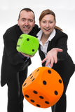 The die is cast. Man and women throwing dice Stock Photo