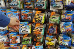 Die-cast toy cars in a blister pack in a store display royalty free stock photos