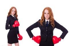 Die Collage der Frauengeschäftsfrau mit Boxhandschuhen auf Weiß Stockbild