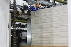 Chain in die cutting machine. Die cutting machine for corrugated paper box processing Stock Images