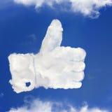 Die Daumen oben von den Wolken Stockbilder