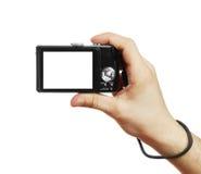 Die Digitalkamera in einer Hand Lizenzfreie Stockfotografie