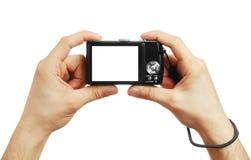 Die Digitalkamera in einer Hand Lizenzfreie Stockfotos