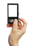 Die Digitalkamera in einer Hand Stockfotografie