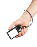 Die Digitalkamera in einer Hand Lizenzfreies Stockfoto