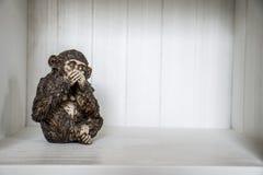 Die drei Affe-Skulptur hören, dass zu sprechen 4 sehen Sie Lizenzfreies Stockbild