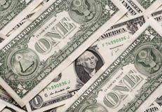 Die eine Dollar Begriffshintergrund Stockfoto