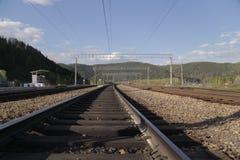 Die Eisenbahn in den Bergen Stockfotos