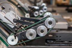 Die Fabrikmaschinen im Arbeitsfluß auf der Manufaktur Stockfoto