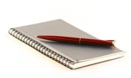 Die Feder und das Notizbuch Stockbilder