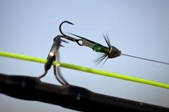 Die Fischerei fliegt auf eine Stange Stockbild
