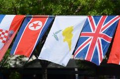 Die Flaggen von Nordkorea, von Zypern und von Vereinigtem Königreich Stockfotos