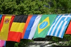 Die Flaggen von Spanien, von Belgien, von Russland, von Brasilien und von Griechenland Lizenzfreie Stockfotografie