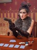 Die Frau in der strengen Kleidung in einem Retrostil. Lizenzfreie Stockbilder
