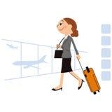 Die Frau, die auf eine Geschäftsauslandsreise geht Stockbild