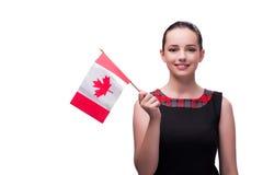 Die Frau, die kanadische Flagge lokalisiert auf Weiß hält Lizenzfreies Stockfoto