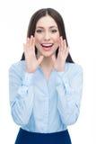 Die Frau, die mit den Händen nennt, nähern sich ihrem Mund Lizenzfreies Stockbild