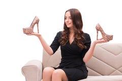 Die Frau, die schwierige Wahl zwischen Schuhen hat Stockfoto