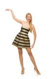 Die Frau in gestreiftem Gold und schwarzen im Kleid lokalisiert auf Weiß Lizenzfreie Stockfotos