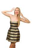 Die Frau in gestreiftem Gold und schwarzen im Kleid lokalisiert auf Weiß Lizenzfreies Stockbild
