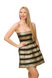 Die Frau in gestreiftem Gold und schwarzen im Kleid lokalisiert auf Weiß Stockfotos