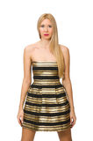 Die Frau in gestreiftem Gold und schwarzen im Kleid lokalisiert auf Weiß Lizenzfreie Stockbilder