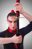 Die Frau im japanischen Kampfkunstkonzept Stockfotografie