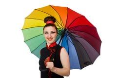 Die Frau mit dem bunten Regenschirm lokalisiert auf Weiß Stockbild