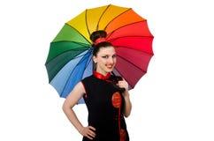 Die Frau mit dem bunten Regenschirm lokalisiert auf Weiß Stockbilder