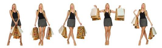 Die Frau mit den Einkaufstaschen lokalisiert auf Weiß Lizenzfreie Stockbilder
