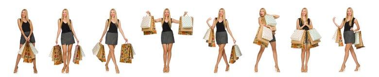 Die Frau mit den Einkaufstaschen lokalisiert auf Weiß Stockbild