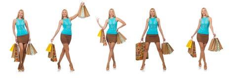 Die Frau mit den Einkaufstaschen lokalisiert auf Weiß Stockbilder