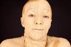 Die Frau mit der Gesichtsmaske Stockfotografie