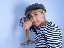 Die Frau mit einem Hammer Lizenzfreies Stockbild